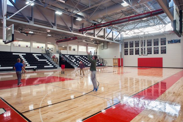 The upper concourse is connected to the court with bleacher seating.