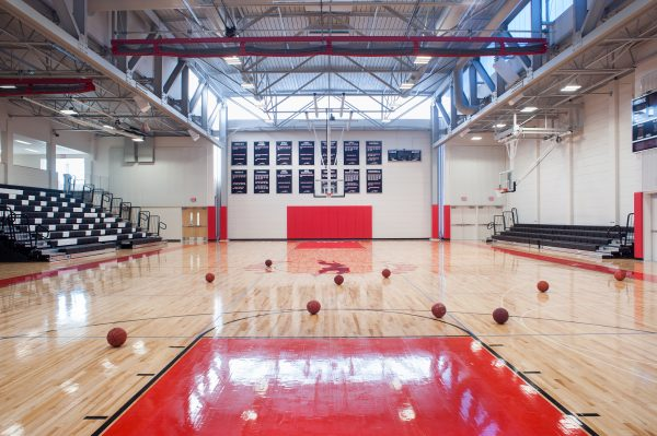 The gym is lit with natural light from above, reducing the need for lighting during the day.