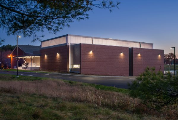The new gymnasium and entry at Lisbon High School are well lit for way-finding in the evening
