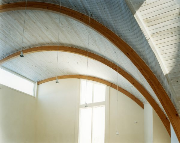 A detail of the curved wooden trusses